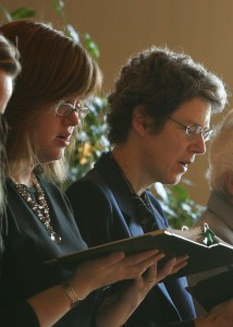 Sister Lynne praying with the community