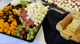 platters of fruit and cheese ready for a reception