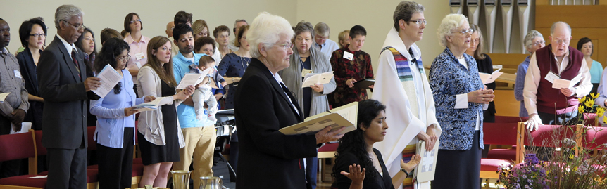 Sisters Joanne, Rosy, Mary David and Lynne and larger community at Rosy's first monastic profession
