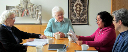 Sisters Joanne and Mary David, Paz and Sister Lynne gathered for conversation around the table.