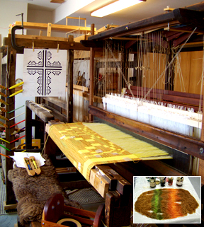 Loom set up for weaving large wall tapestry in gold - inset with yarn dyed in varigated colors