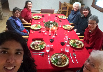 Sisters and family gathered around festive table for Christmas