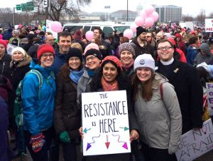 """Sister Rosy and friends holding sign reading """"The Resistance is HERE"""""""
